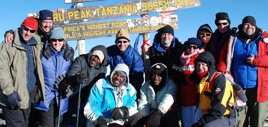 The Kilimanjaro Experts plus trekkers safely at the top