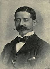 HH Johnston with large waxed moustache and spotty bow tie