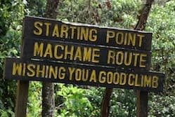 A wooden sign at the start of the Machame Trail
