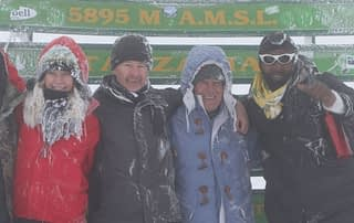 Roly Pitts at the summit in the snow