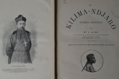 Inside cover of Mgr Le Roy's Kilima-ndjaro book with the author on the left-hand page and a silhouette of a local tribesman underneath the book's title on the right-hand page
