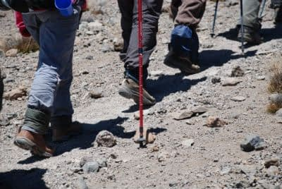 Close-up of boots walking up the desert slopes Kilimanjaro