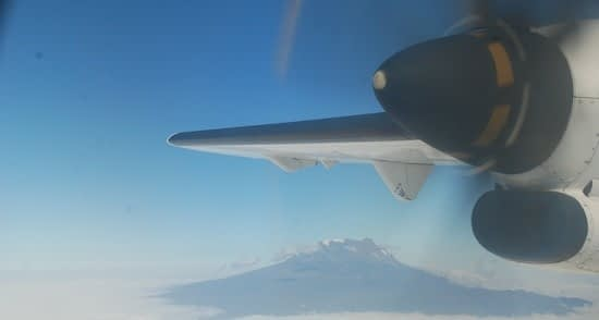 Aerial shot of Kilimanjaro with aeroplane wing and propellor in the foreground