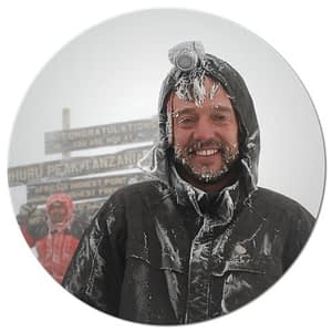 Henry Stedman on the summit of Kilimanjaro covered in snow
