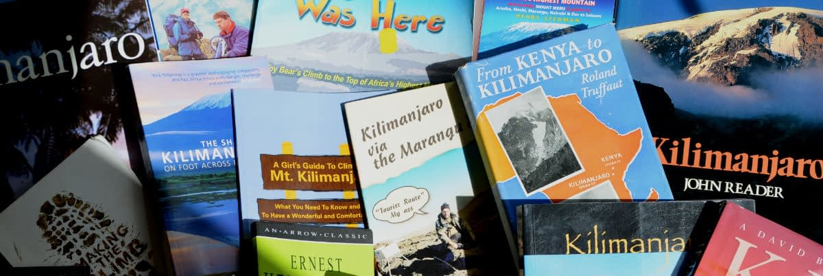 Close-up of a pile of books, all of them about Kilimanjaro