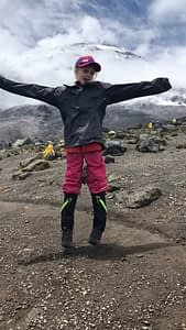 Montannah Kenney, youngest female to reach the top of Kilimanjaro, celebrates at the summit