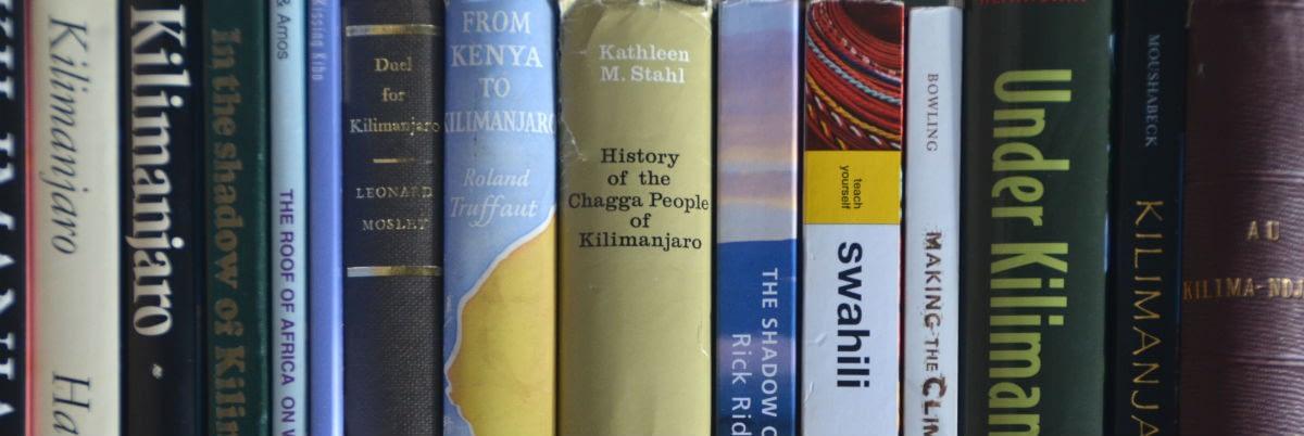 Kili books neatly lined up on a shelf