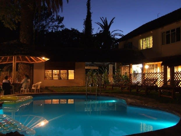 Swimming pool at Outpost in Arusha at night
