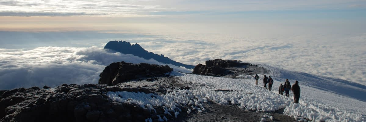 Descending from the summit with Mawenzi rising above the clouds