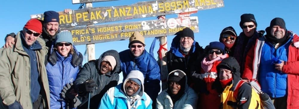 Happy Kilimanjaro Experts at Uhuru Peak