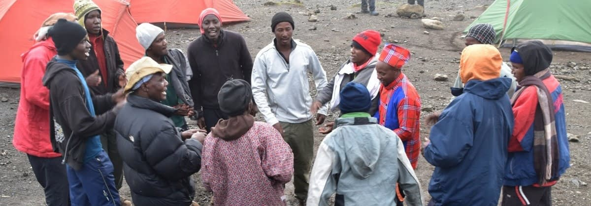 Porters singing and dancing on Kilimanjaro