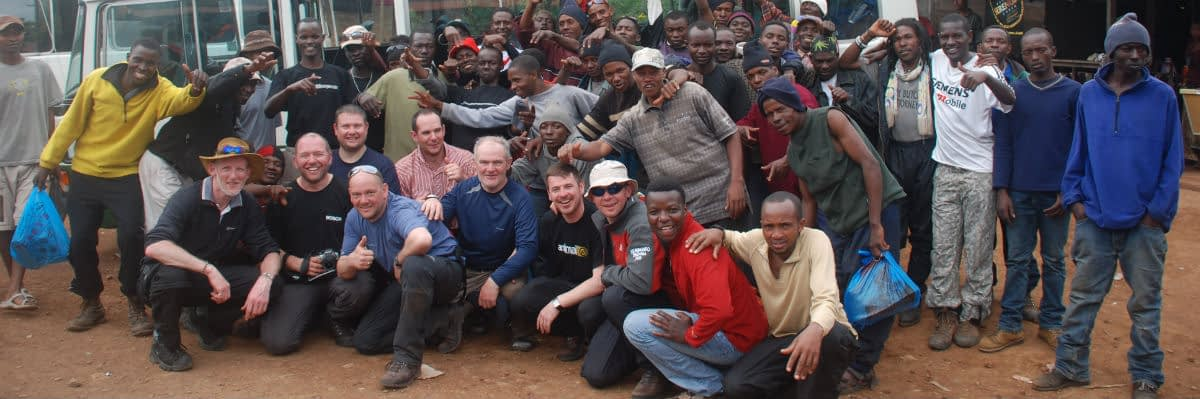 Climbers and crew at the foot of Kilimanjaro