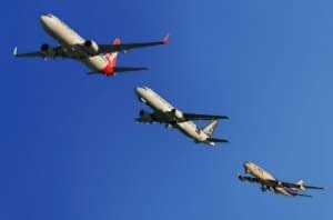 Three aeroplanes flying in a line